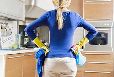 picture of woman deciding wher to start cleaning
